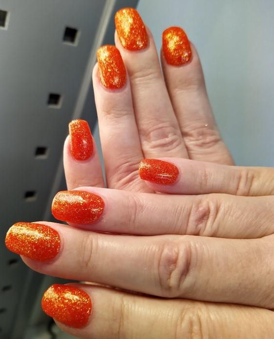 Neon oranssija glitter mandariini Kynnet Ulla Ahtiainen